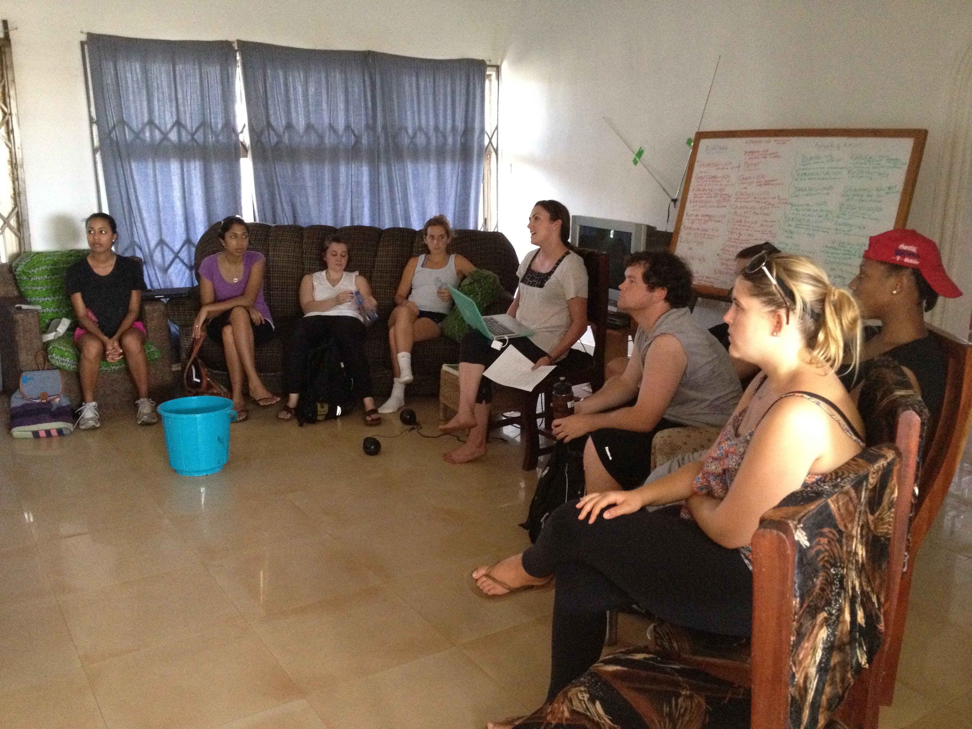 The Fall Fellows listening as Brianan explains her job as CWS' Ghana Country Director