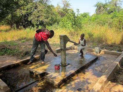 Shak tastes the borehole water in Buhijaa