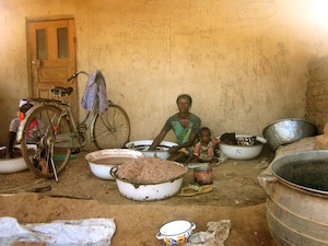 A woman making shea butter in Kpanayili