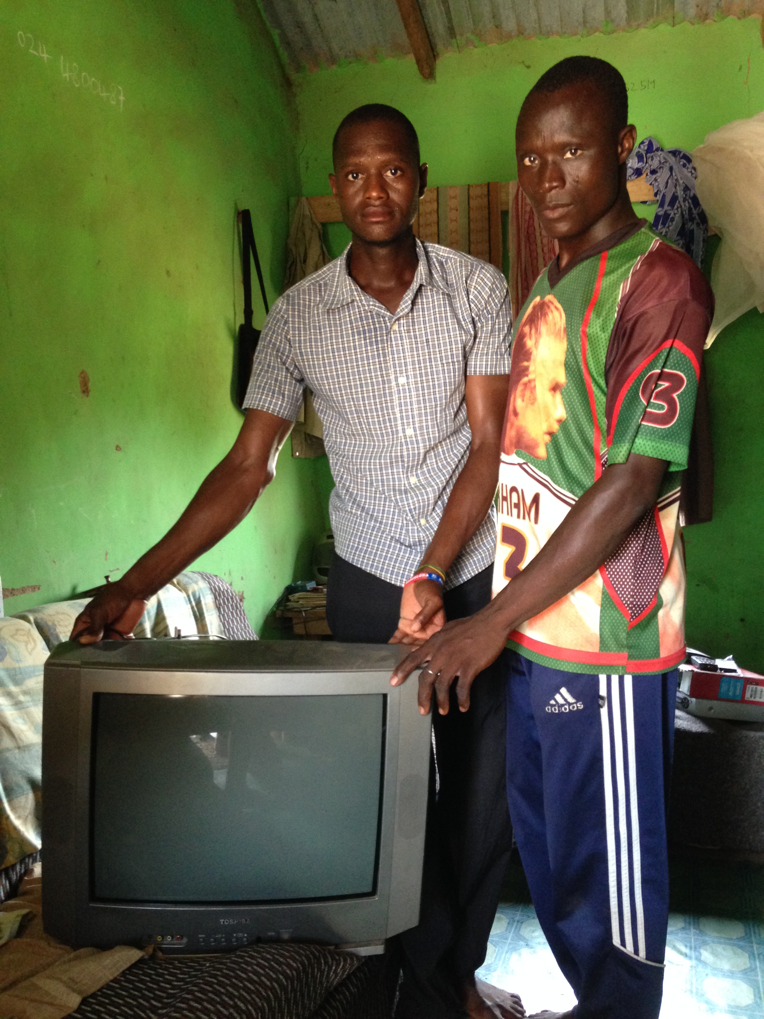 Some people own a tv in a village with no electricity.