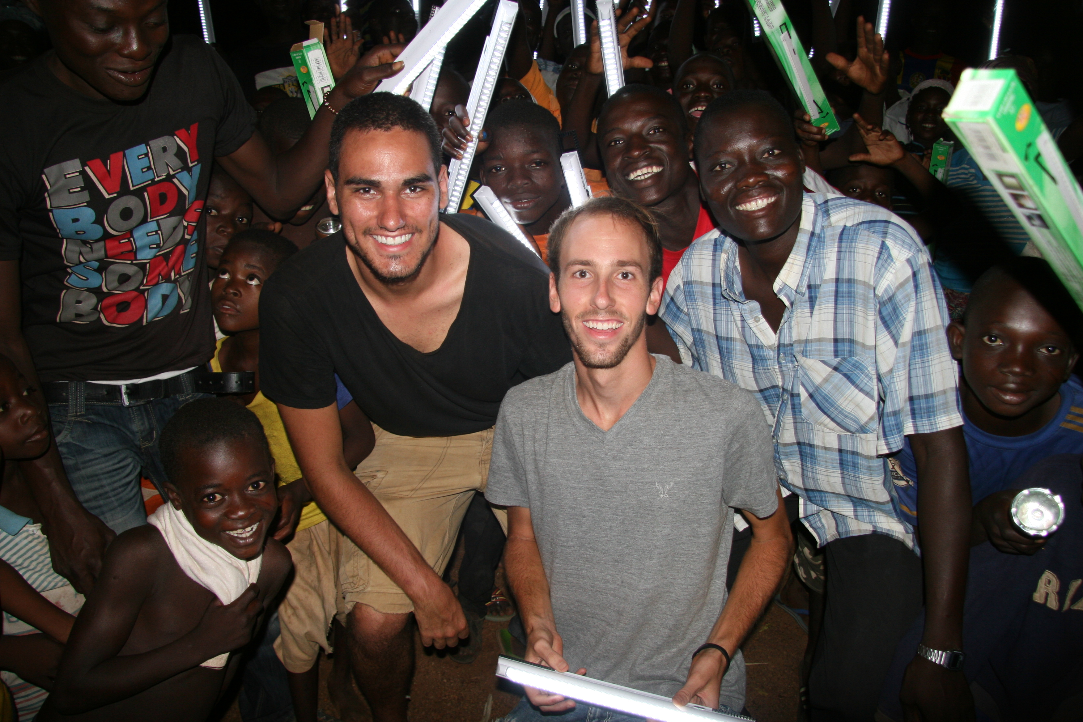 Mark and Ben surrounded by crowds of happy Wambong villagers!