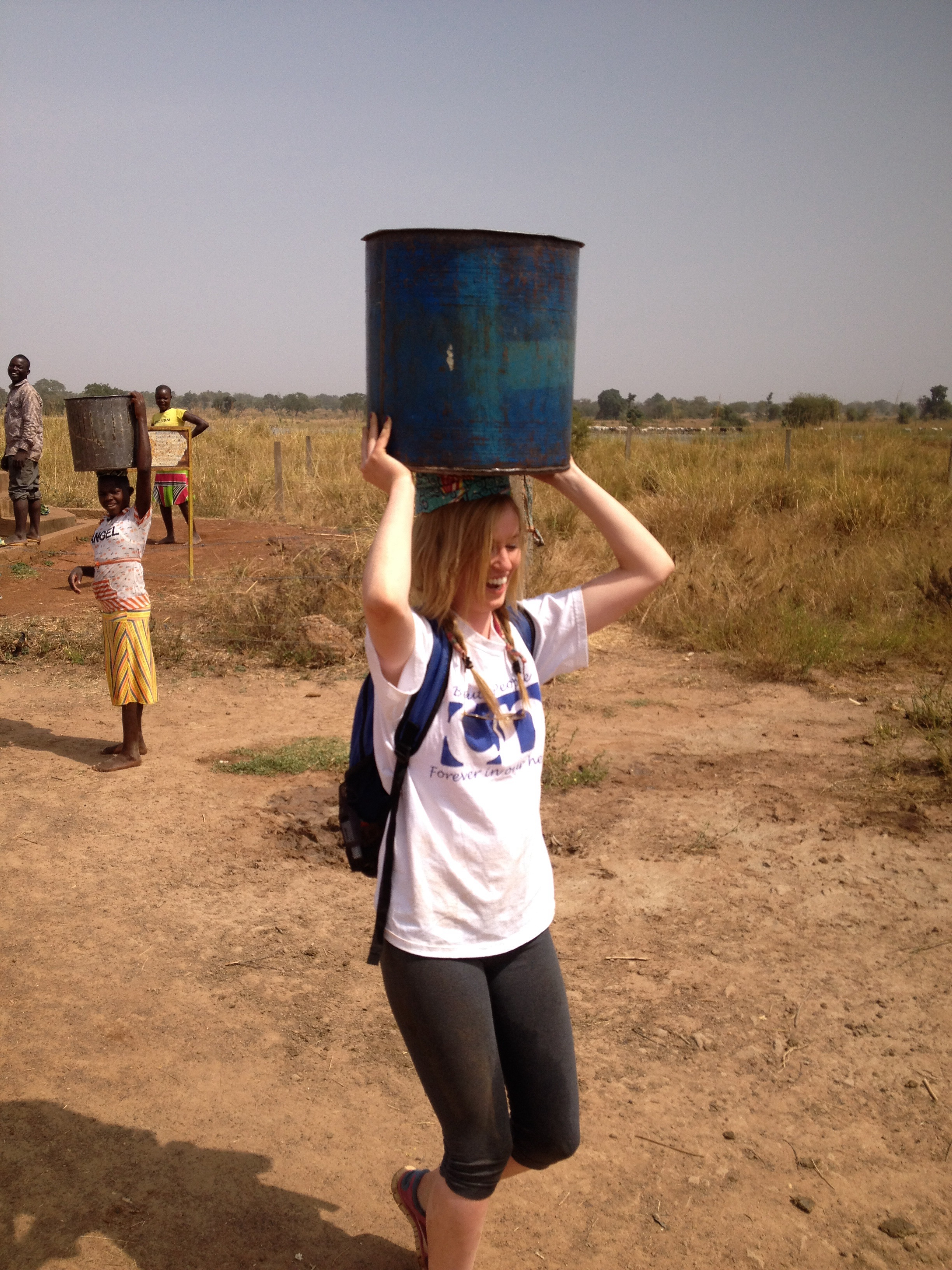 Caroline helps out to collect water