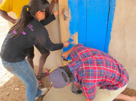 Lucas and Linda paint the door of the solar center