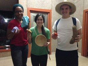 Marsha, Sarah & Jake with their proudest of scavender hunt items-- a yam, callabash and cloth