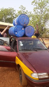 Team TJ loads up the taxi for a drum delivery