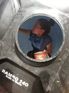 Aly gets serious about polytank cleaning.