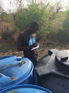Eric taking note of the water levels at the business in Djelo