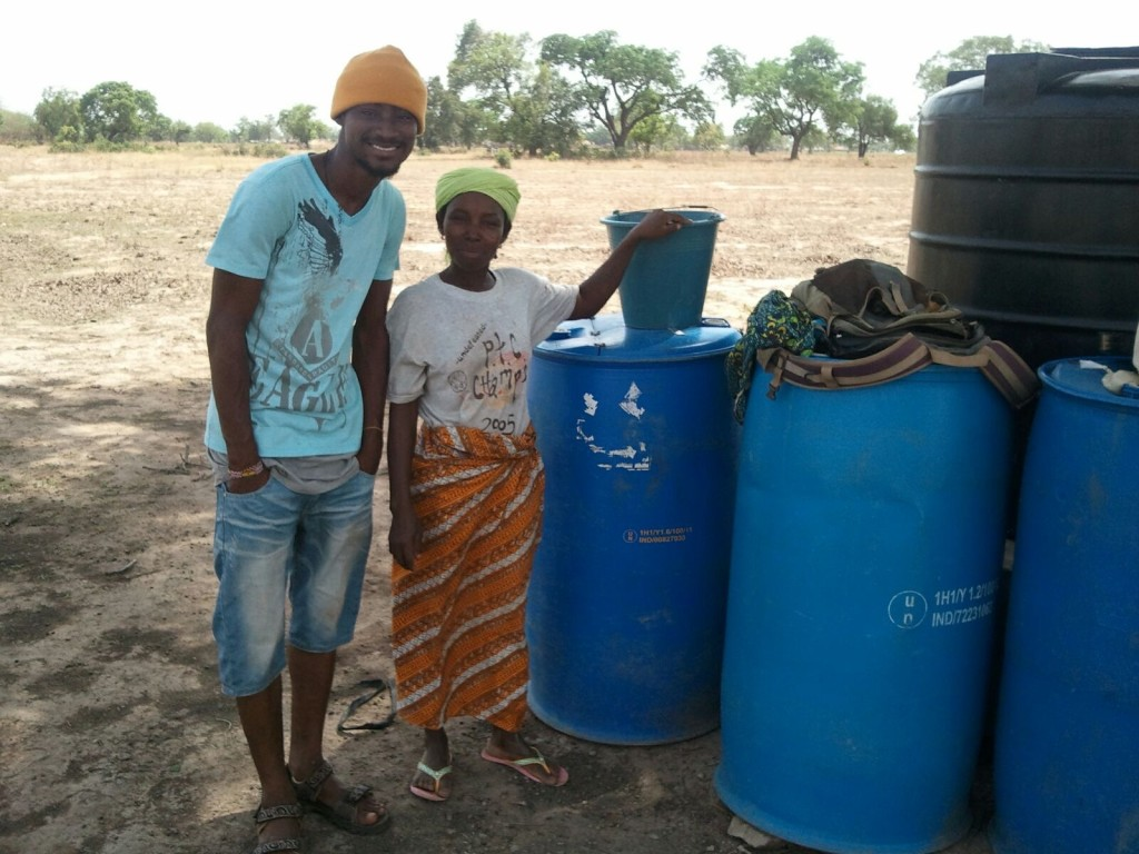 Wahab checking in with Fatima at the water business in Namdu I