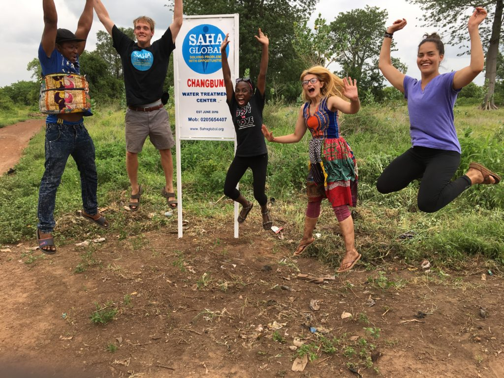 Dzorsah, Greg, Wivine, Jen and Abby in the community of Changbuni