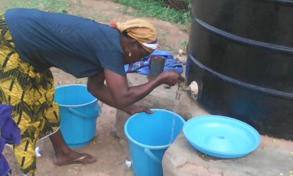 Baramini sells water in Gidanturu