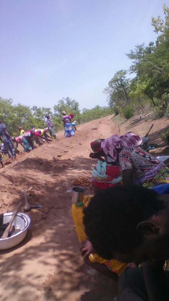 """The women in Komlanyili and Bamvim. They are doing communal labor to construct their new road"""