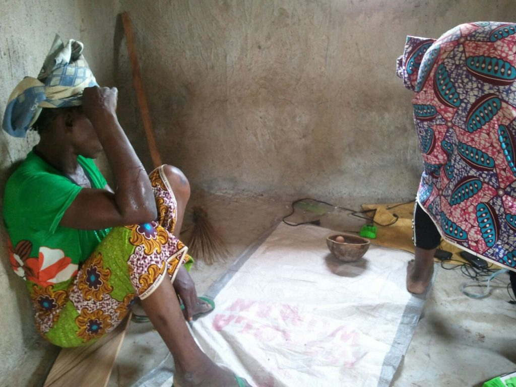 """""""Azara from Kpalguni shows her daughter how to charge things at the center in case she is not around"""" - Wahab monitors in April"""