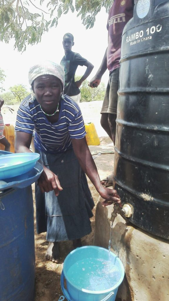 Sanatu makes sales in Kpenchilla. The polytank was leaking but Eric helped fix the problem