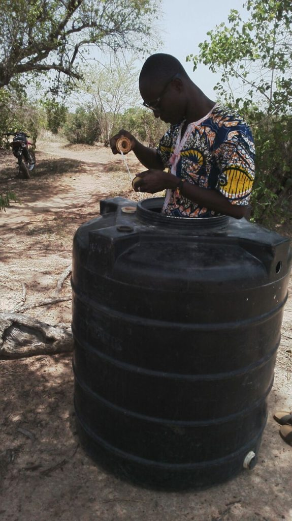 """Sun was scortching, so I brought the polytank under some shade to fix"" - Eric in Kpenchila"