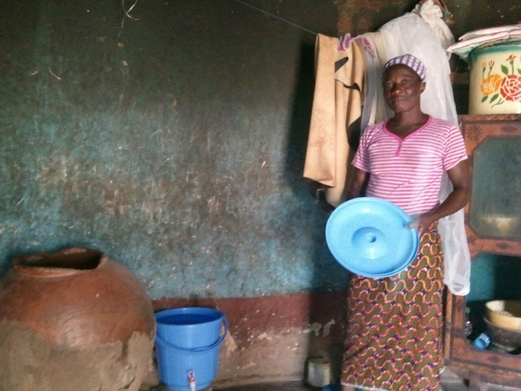 """Household visit with a full bucket of clean water"""
